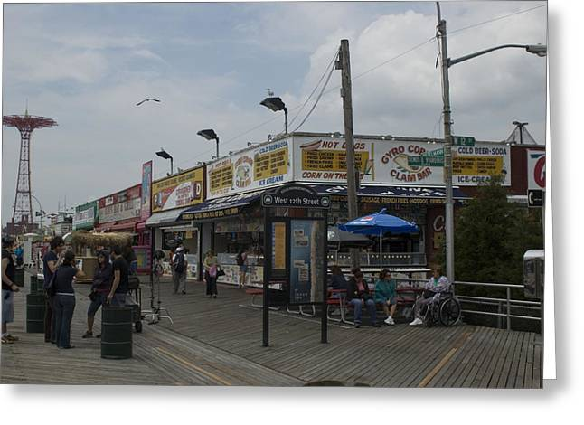 Boardwalk At Coney Island On A Cloudy Greeting Card by Todd Gipstein