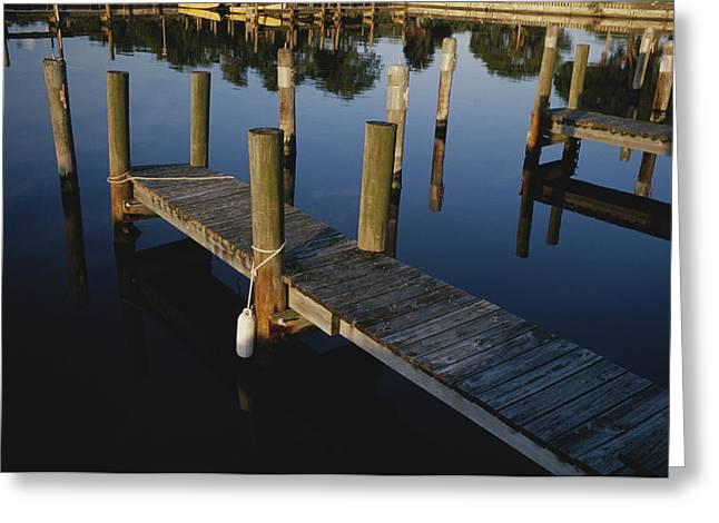 Boat Slips At A Marina On A Calm Greeting Card