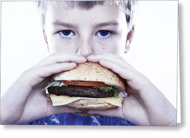 Boy Eating A Burger Greeting Card