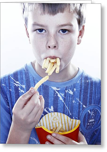 Boy Eating French Fries Greeting Card by Kevin Curtis