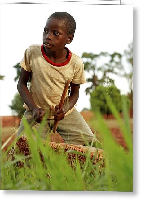 Boy Playing A Drum, Uganda Greeting Card by Mauro Fermariello