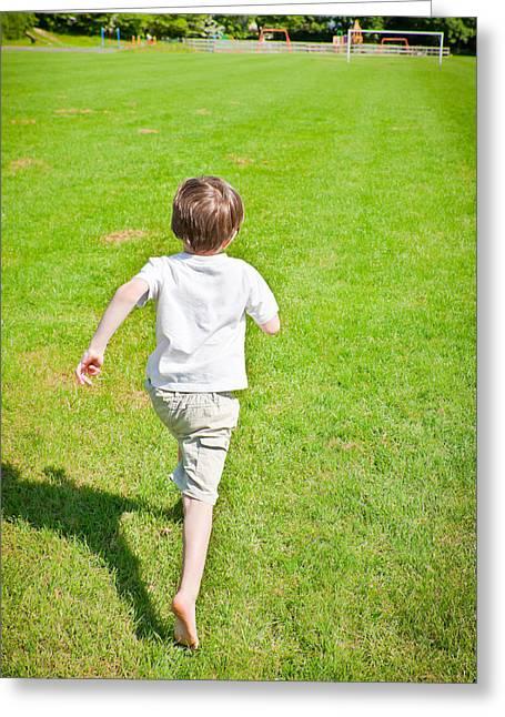 Boy Running Greeting Card by Tom Gowanlock