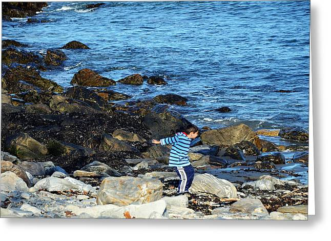 Greeting Card featuring the photograph Boy Throwing A Stone Maine Coast by Maureen E Ritter