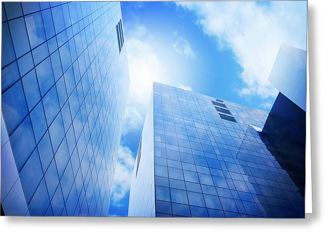 Bright Blue City Buildings With Clouds Greeting Card by Angela Waye