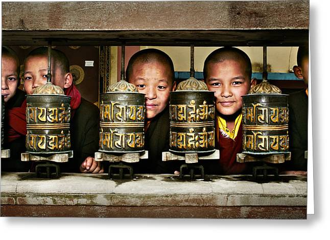 Buddhist Monks In Red Robes Look Out Of The Prayer Wheels With M Greeting Card