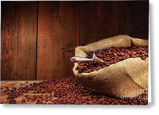 Burlap Sack Of Coffee Beans Against Dark Wood Greeting Card by Sandra Cunningham