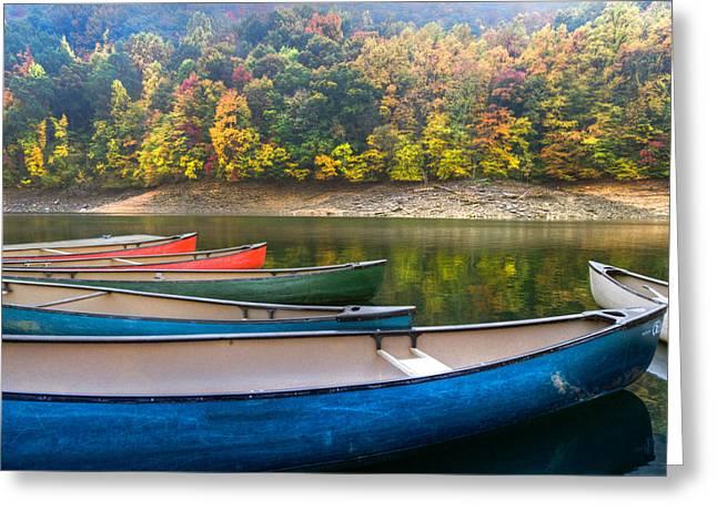 Canoes At Fontana Greeting Card by Debra and Dave Vanderlaan