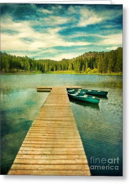 Canoes At The End Of The Dock Greeting Card by Jill Battaglia