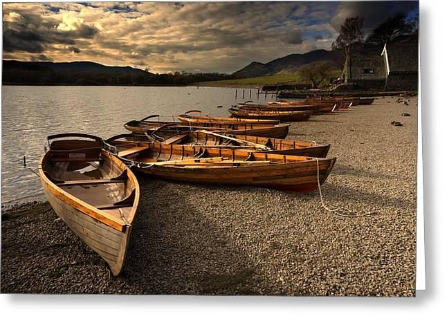 Canoes On The Shore, Keswick, Cumbria Greeting Card by John Short
