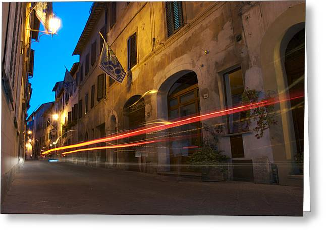 Car Lights Streak Down A Village Street Greeting Card by Heather Perry