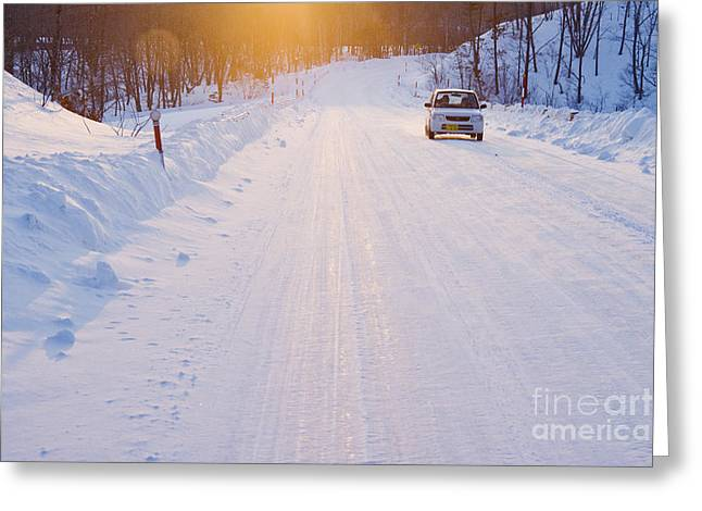 Car On Snow Covered Road Greeting Card by Jeremy Woodhouse