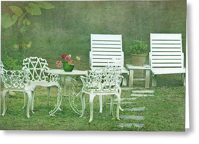 Chairs And Table Set In The Garden. Sun Greeting Card by Lawren Lu