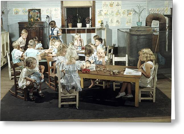 Children Play In A Day Nursery Greeting Card by J Baylor Roberts