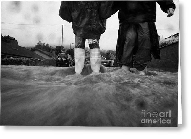 Children Walking In Heavy Rain Storm In The Street Greeting Card by Joe Fox