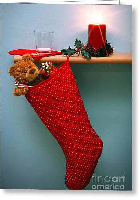 Christmas Stocking Filled With Presents With Empty Milk Glass.  Greeting Card by Richard Thomas
