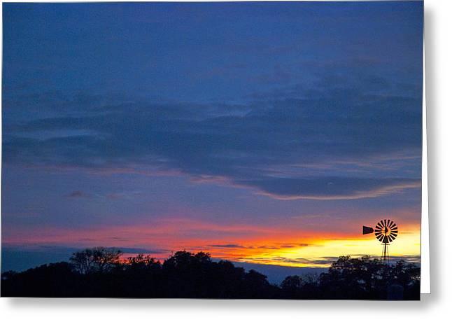 Christmas Sunset Greeting Card by Robert Anschutz