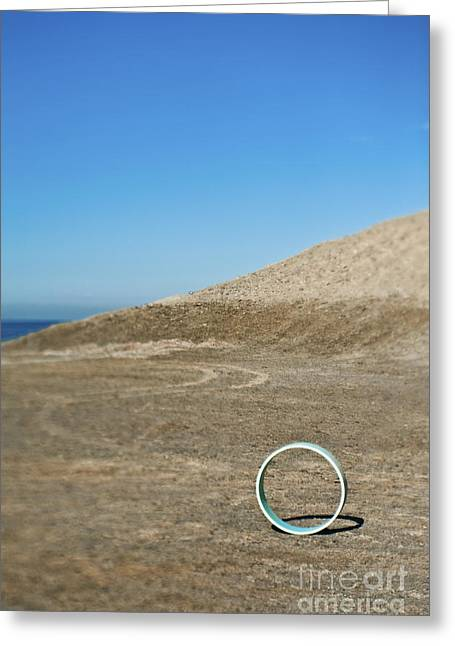 Circular Object On Beach Greeting Card by Eddy Joaquim