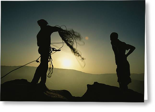 Climbers Get Ready To Descend Greeting Card by Carsten Peter