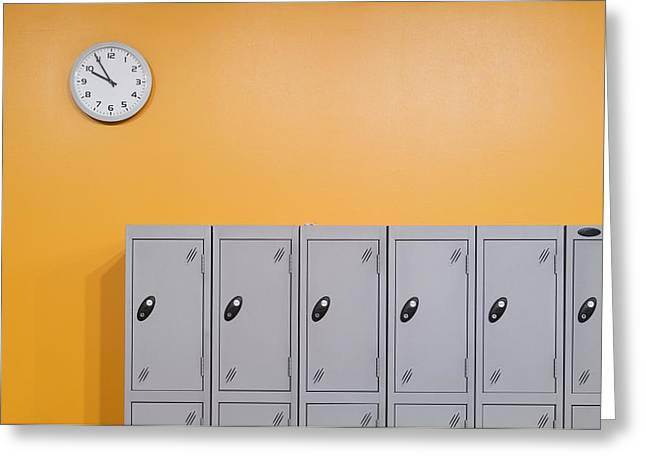 Clock On An Orange Wall Above Lockers Greeting Card
