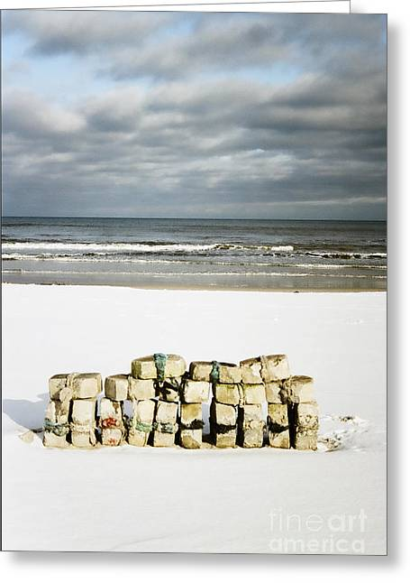 Concrete Bricks On A Snowy Beach Greeting Card by Agnieszka Kubica