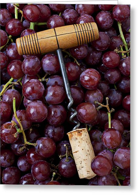 Corkscrew And Wine Cork On Red Grapes Greeting Card