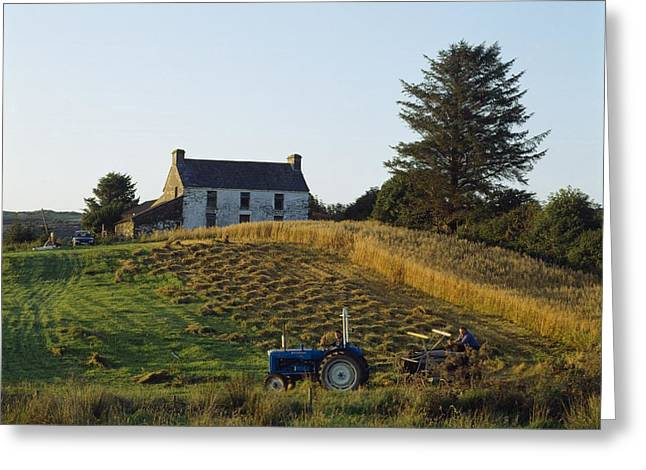 County Cork, Ireland Farmer On Tractor Greeting Card by Ken Welsh