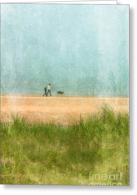 Couple On Beach With Dog Greeting Card by Jill Battaglia
