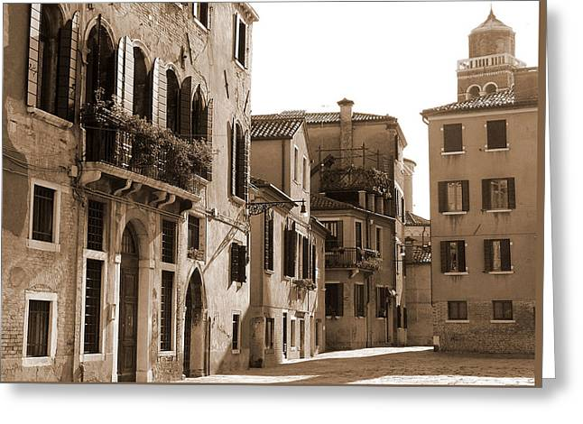 Courtyard By The Church Greeting Card by Donna Corless