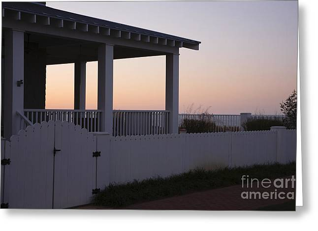 Covered Porch And Fence At Sunset Greeting Card by Roberto Westbrook