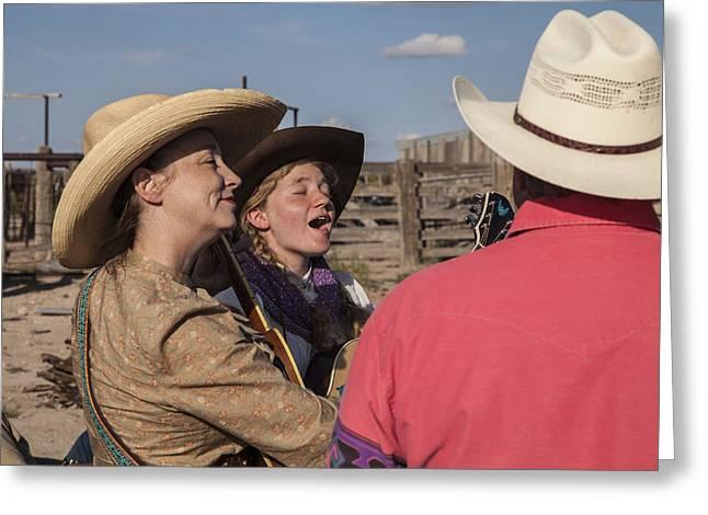 Cowgirl Serenading The Cowboys Greeting Card by Ralph Brannan