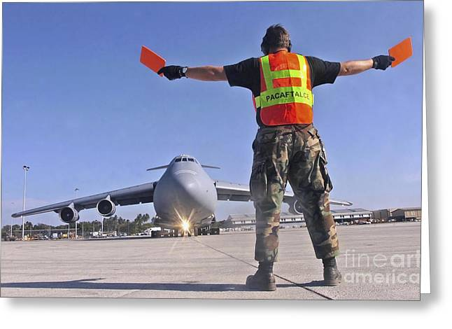 Crew Chief Marshals A C-5 Galaxy Greeting Card by Stocktrek Images