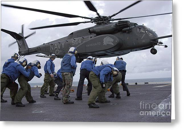 Crew Members Brace Themselves As An Greeting Card by Stocktrek Images