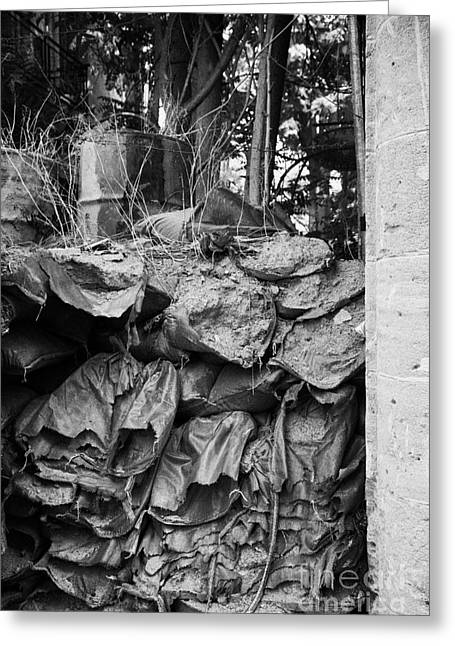 decaying sandbagged wall from 1974 at UN buffer zone in the green line dividing nicosia cyprus Greeting Card