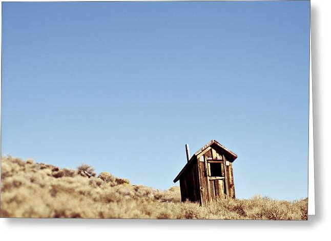 Dilapidated Outhouse On Hillside Greeting Card by Eddy Joaquim