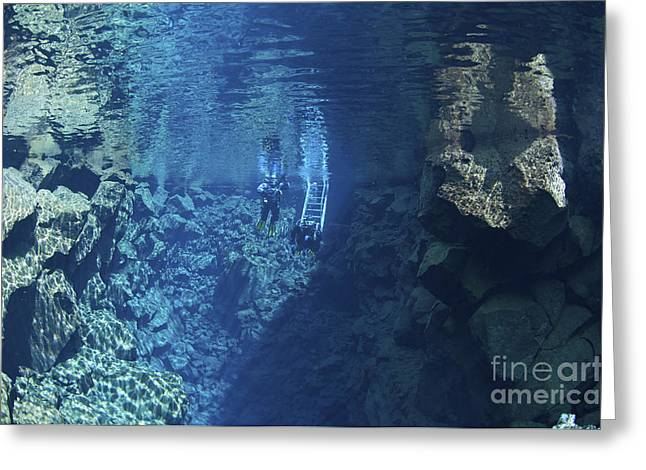 Dry Suit Divers Entering The Gin Clear Greeting Card by Mathieu Meur