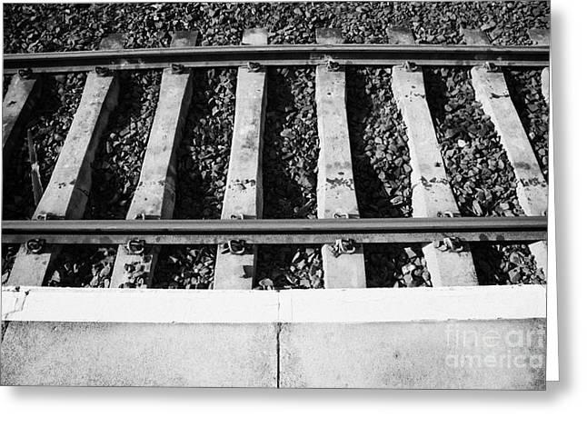Edge Of Railway Station Platform And Track Northern Ireland Uk Greeting Card by Joe Fox