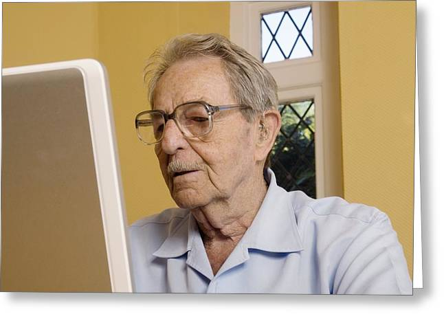 Elderly Man Using A Laptop Computer Greeting Card by Steve Horrell