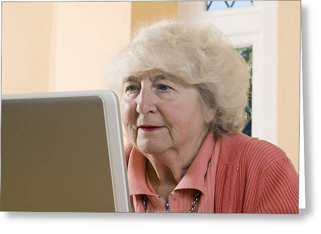 Elderly Woman Using A Laptop Computer Greeting Card by Steve Horrell