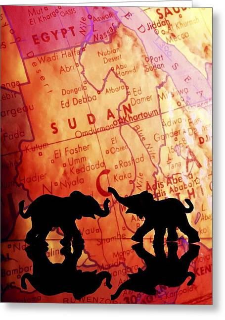 Elephant Silhouettes In Front Of A Map Greeting Card by Chris Knorr