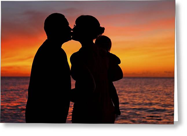 Family Silhouettes At Sunset Greeting Card