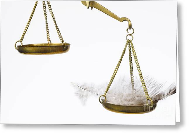 Feather On Weighing Scales Greeting Card by Sami Sarkis