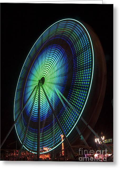 Ferris Wheel Lit Shades Of Green And Blue Greeting Card