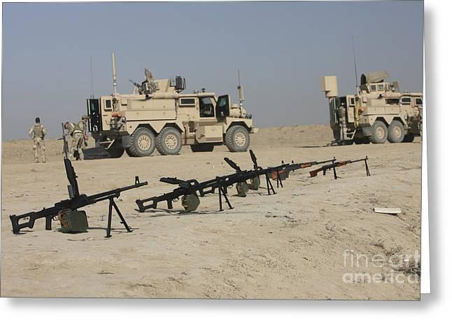 Firearms Sit Ready On A Firing Range Greeting Card