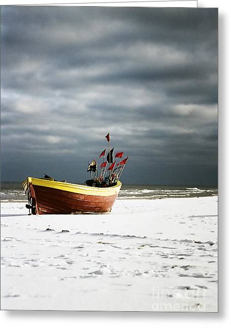 Greeting Card featuring the photograph Fishermen's Boat On Snowy Beach by Agnieszka Kubica