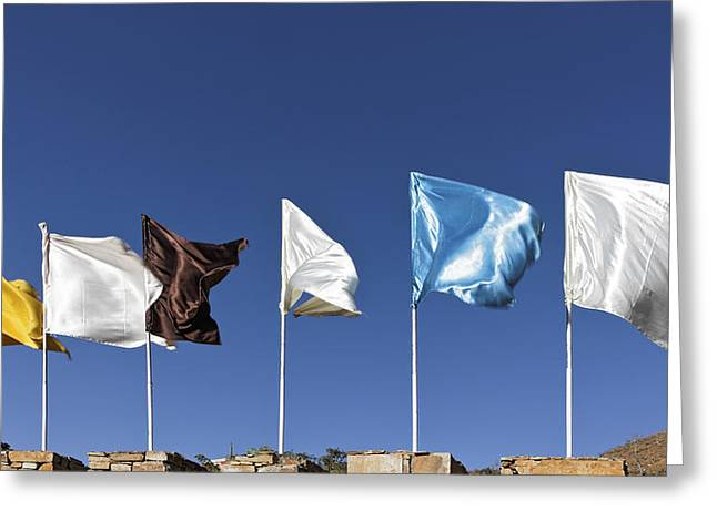 Flags Fluttering Against Blue Sky Greeting Card by Kantilal Patel