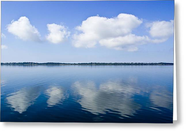 Fluffy Clouds Float Over A Perfectly Greeting Card by Jason Edwards
