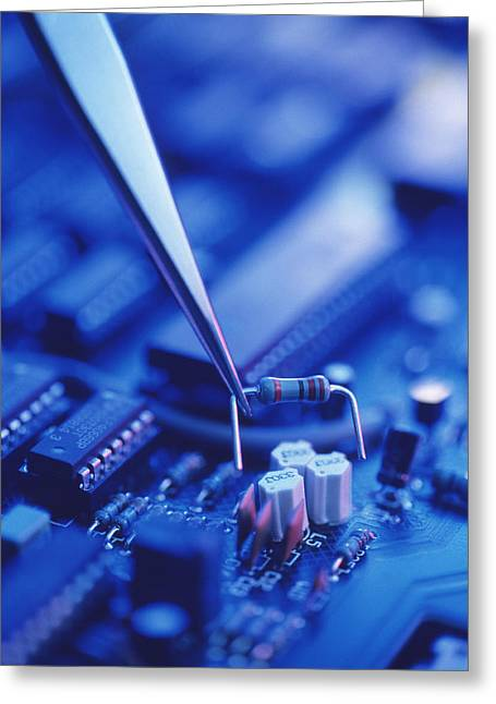 Forceps Holding A Resistor Over A Circuit Board Greeting Card by Chris Knapton