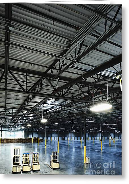 Forklifts In An Empty Warehouse Greeting Card by Jetta Productions, Inc