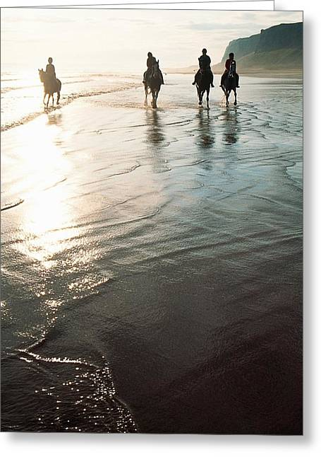 Four People Horseback Riding On A Greeting Card