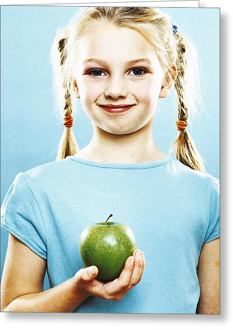 Girl Holding An Apple Greeting Card by Kevin Curtis